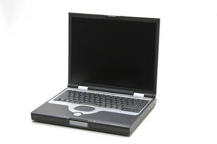 Come caricare una batteria portatile Compaq