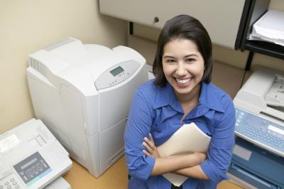 Come ricarica di inchiostro Cartidges in una stampante Epson CX7400